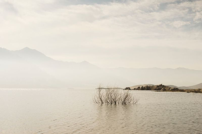 Tranquility Tranquil Scene Water Scenics Nature Beauty In Nature Mountain No People Outdoors Waterfront Day Sea Sky Mountain Range Minimalism White Copy Space