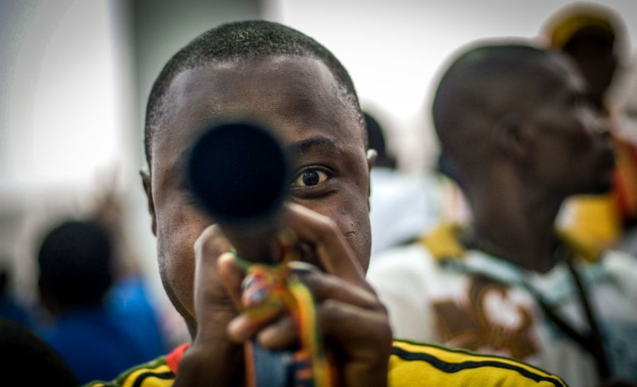 Accra G African Football Ghana The Week on EyeEm The Fan African Soccer Match Close-up Crowd Focus On Foreground Get The Party Started Headshot In The Mood In The Stadium Leisure Activity Mood Portrait Soccer Fan Soccer Field Trumpet