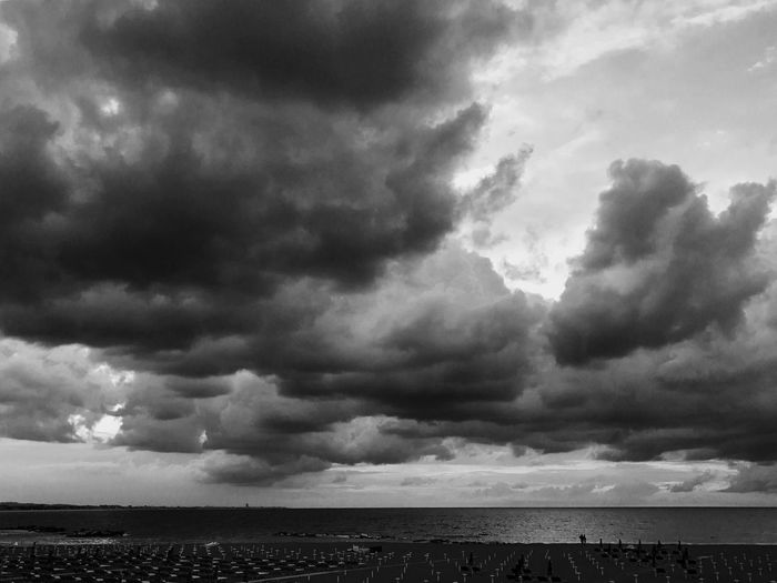 View of storm clouds over sea