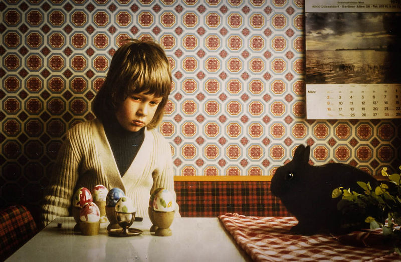 Boy Looking Easter Eggs On Table At Home