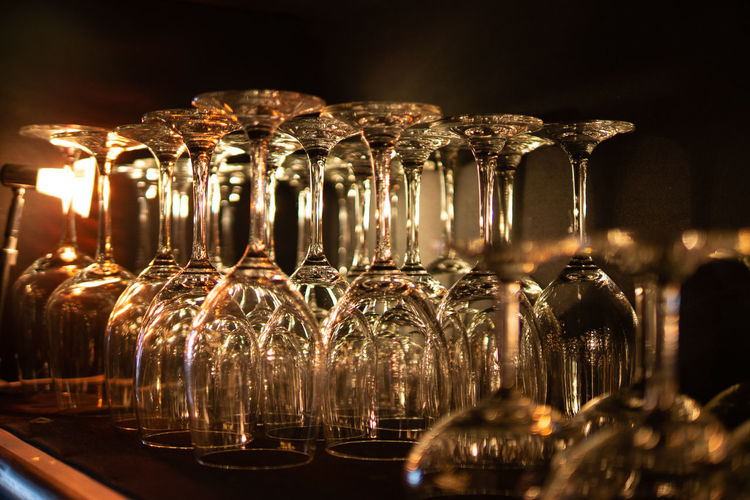 Glass of wine bottles on table
