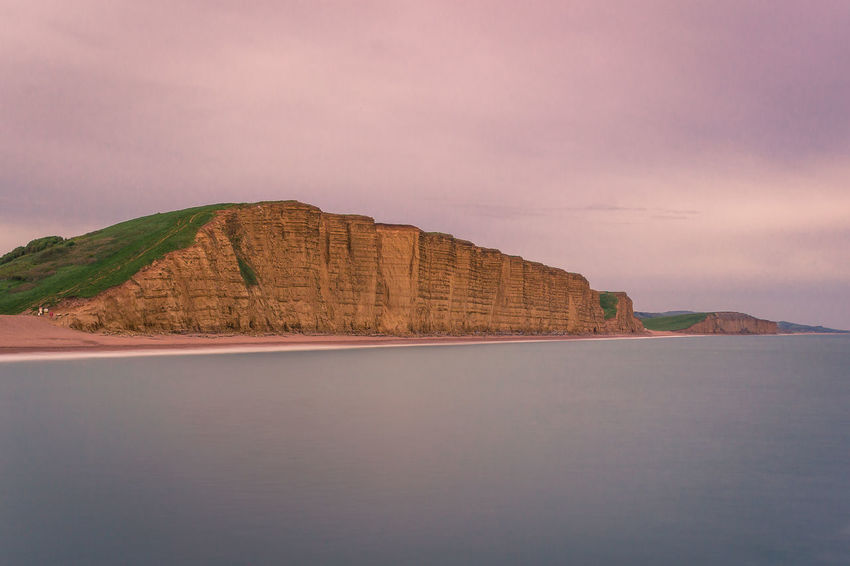 Dorset Arid Climate Beauty In Nature Cloud - Sky Formation Idyllic Land Long Exposure Mountain Nature No People Non-urban Scene Outdoors Rock Rock - Object Rock Formation Scenics - Nature Sea Sky Solid Tranquil Scene Tranquility Water Waterfront