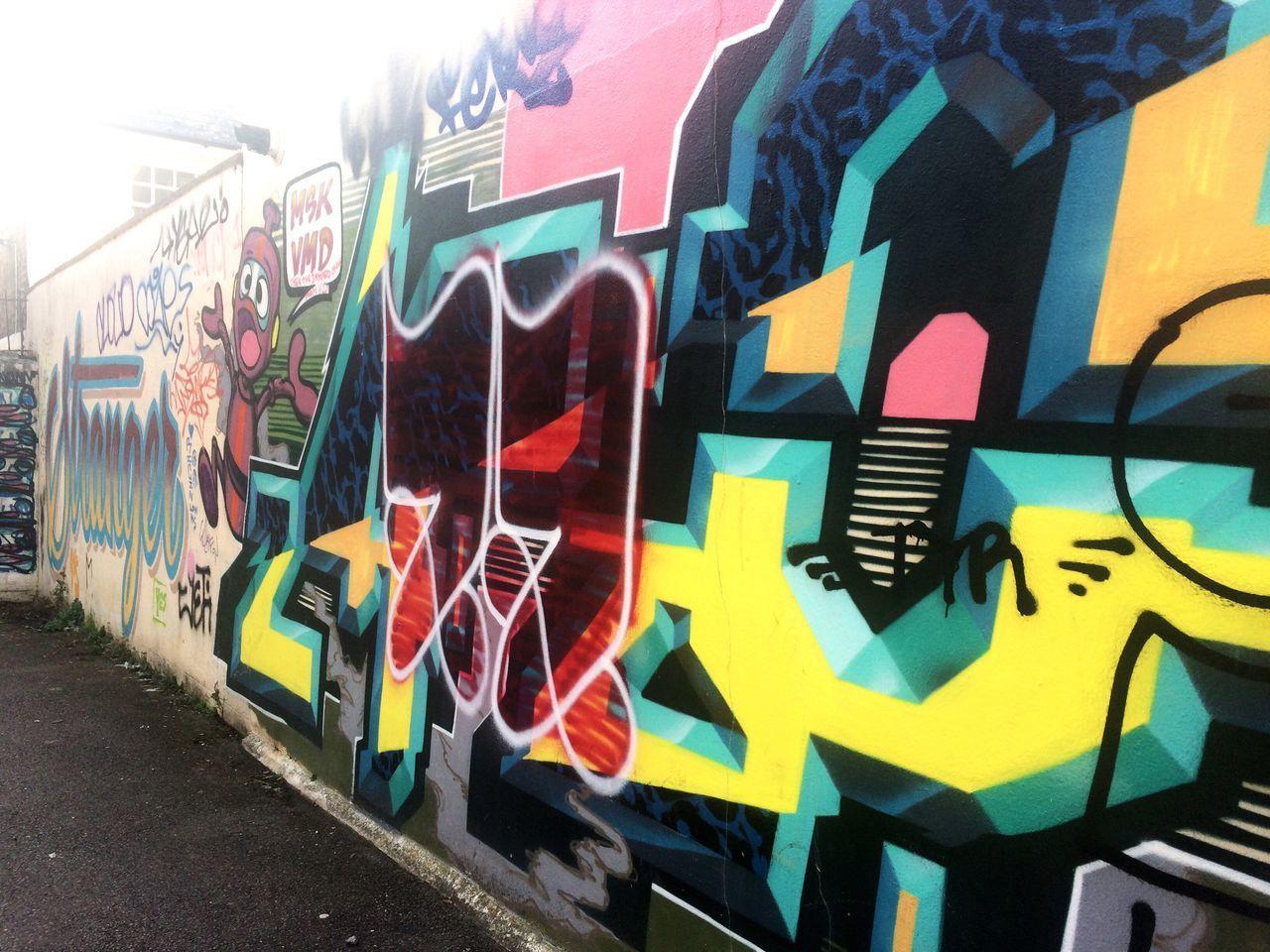 graffiti, train - vehicle, rail transportation, transportation, multi colored, outdoors, no people, public transportation, day, stationary, sky