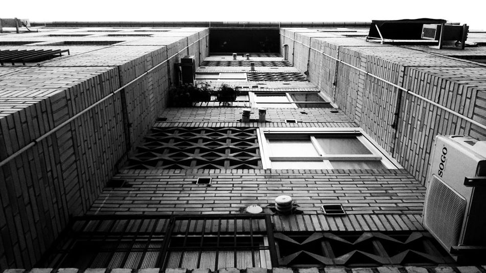 Brick Wall Lattice Low Angle View Pattern Pieces Architecture Black And White Blackandwhite Brick Building Building Building Exterior Built Structure City Day High Angle View Lifestyles Monochrome Outdoors Pattern Railing Residential District Windows