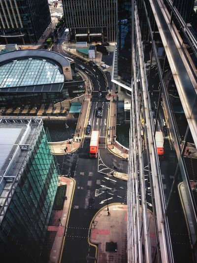 Canary wharf City Architecture Transportation Traffic Car Built Structure City Life High Angle View Road Street Aerial View Building Exterior Cityscape City Street Mode Of Transport Modern Road Intersection Illuminated Outdoors Skyscraper City Life Moody City View  The Week On EyeEm Cityscape Postcode Postcards #urbanana: The Urban Playground