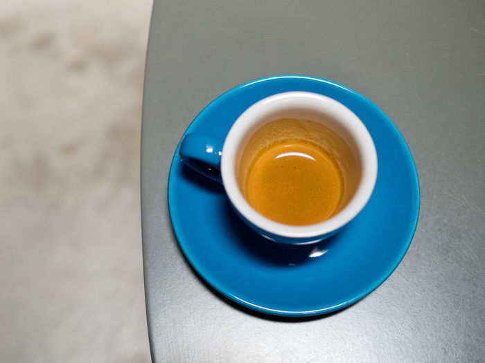 Selective focused on blue espresso cup with almost empty content and some coffee liquid residue with defocused background. Architecture Beverage Breakfast Business Caffeine Espresso Latte Aroma Cafe Coffee Coffee - Drink Coffee Cup Crockery Cup Drink Enjoying Life Food And Drink Frothy Drink Frothymilk Kickstart Milk Mug Non-alcoholic Beverage Refreshment Relax