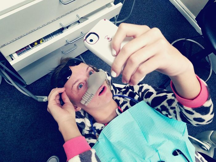 High angle view of young woman in dentist chair