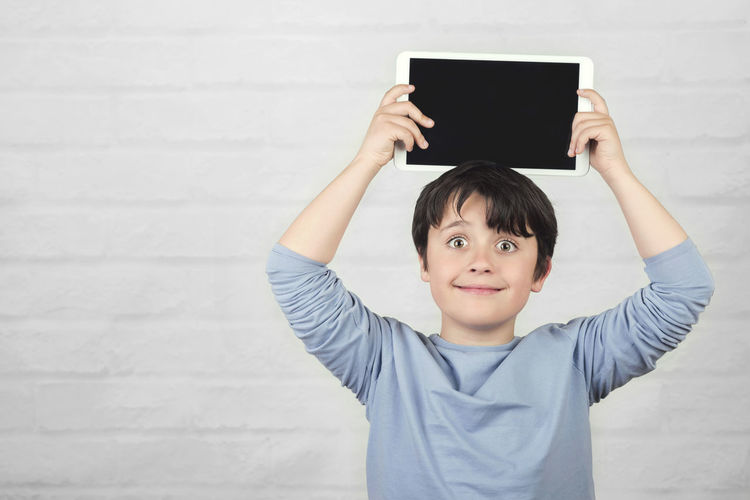 Child Holding Smiling Portrait Screen Tablet Digital Computer Communication Student Happy Internet Happiness Concept Technology Cyber Space Fun Funny Education Lifestyle Smile Connection Learning Play Entertainment