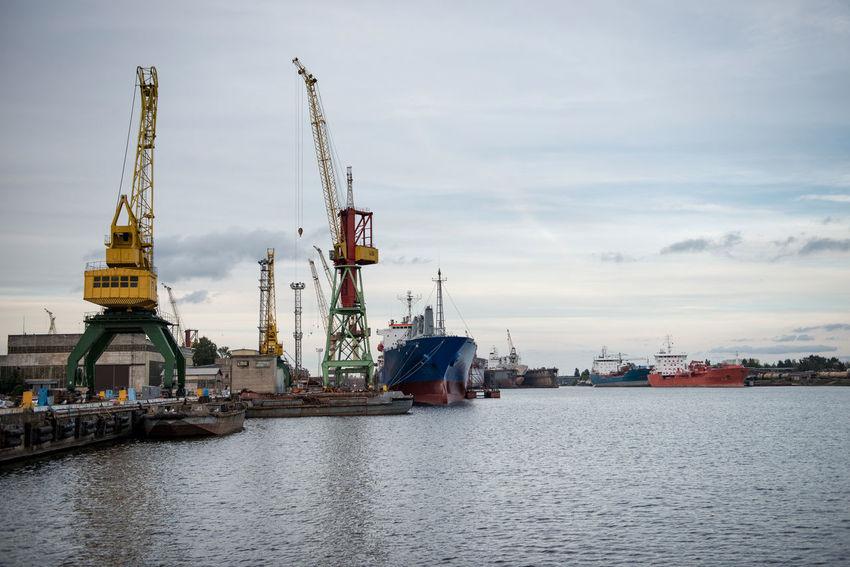 Ship and port cranes at repair area. Cranes Harbor Heavy Industry Transport Boats Docks Equipment Export Import Load Logistic Material Port Repair Scrap Sea Seaside Steel Storage Terminal Transshipment Terminal Unload Vessel
