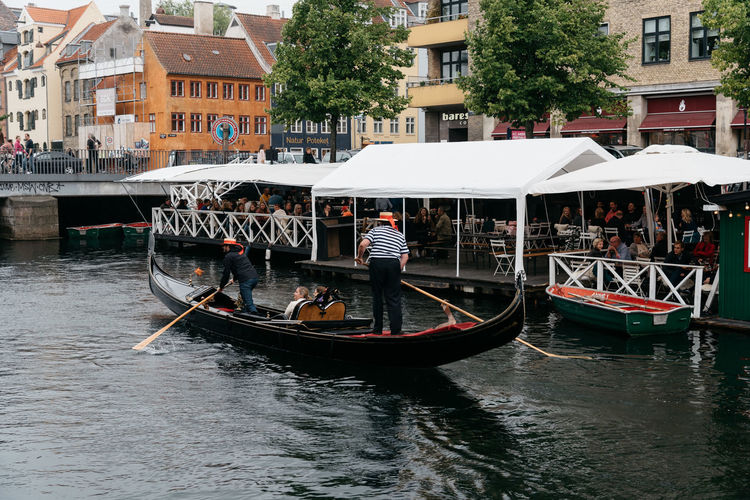 Gondola in the harbor of Copenhagen a cloudy day of summer Architecture Boat Canal City Cityscape Cloudy Copenhagen Gondola Harbor Landmark Leisure Activity Nordic People S Scandinavia Sea Sightseeing Summer Terrace Tourist Tourist Attraction  Travel Travel Destinations