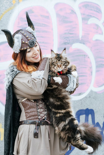 Smooth viking. Smile One Person Bonding Carnival - Celebration Event Viking Viking Costume Costume Woman One Woman Only People Real People Domestic Animals Friendship Pets Portrait Warm Clothing Smiling Happiness Looking At Camera Domestic Cat Feline Cat Fur #NotYourCliche Love Letter Streetwise Photography