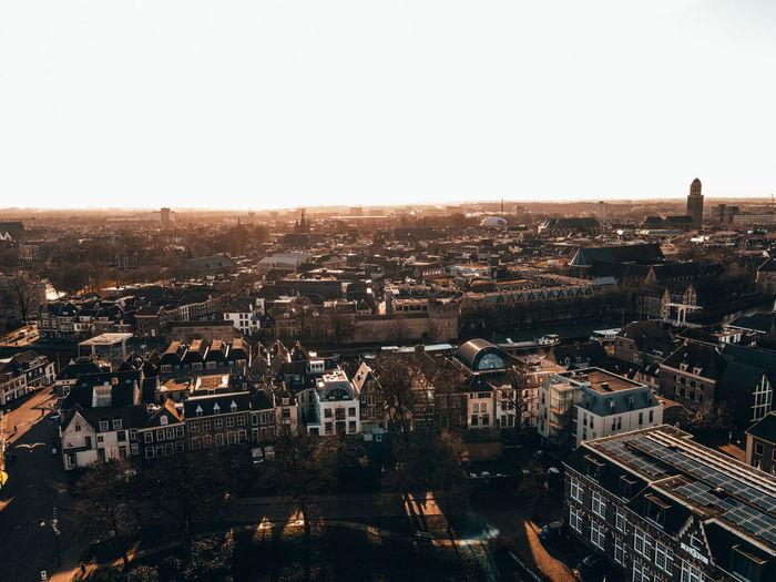 Drone city birds eye view at sunrise