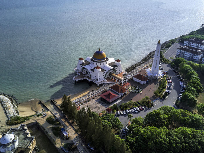Aerial view Melaka Strait Mosque at Pulau Melaka Melaka City Eagle Eyes View Melacca Straits Mosque Architecture Beach Belief Built Structure City Day Dome Drone Image Floating Mosque High Angle View Minaret Nature Place Of Worship Religion Sea Selat Melaka Shore Top Down View Tourism Travel Travel Destinations Tree Water