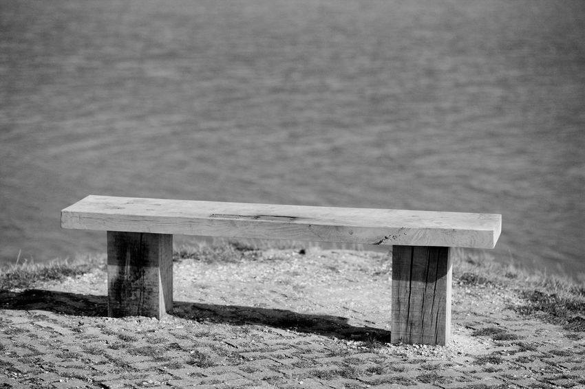 The Bench Bench Black & White Relaxing Blackandwhite Day No People Outdoors Sea Sun Wood - Material Wooden Bench