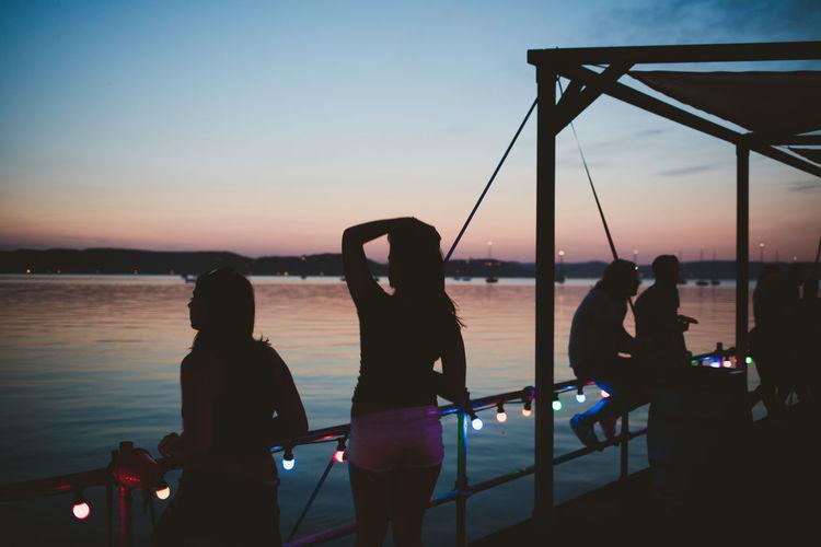 Festival season Beach Festival Lake Party Silhouette Sunset Twilight Water