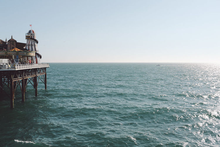 Palace Pier By Sea Against Clear Sky On Sunny Day