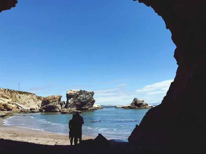 Live For The Story relationship goals retreat Rock - Object Sea Rock Formation Nature Beach Real People Water Leisure Activity One Person Day Scenics Blue Beauty In Nature Men Lifestyles Tranquil Scene Clear Sky Outdoors Sky Full Length A Couple IPhone Photography View From A Cave Pelicans Breathing Space