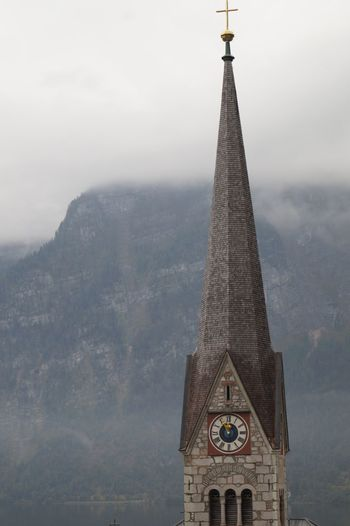Low angle view of cathedral against sky during foggy weather