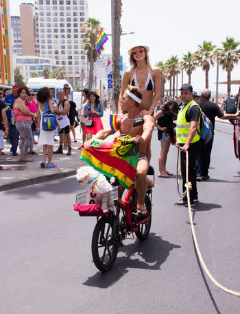 Tel Aviv, Israel, June 03, 2016: Members of the traditional yearly pride parade surrounded by other people in Tel Aviv, Israel Actions Celebrations Civil Colored Colors Cultures Day Flag Freedom Holidays Homosexual Love Lesbian Lifestyles Man Motion Multi Parade Patriotism Pride Rainbow Street Symbol Transgender Transsexual Woman
