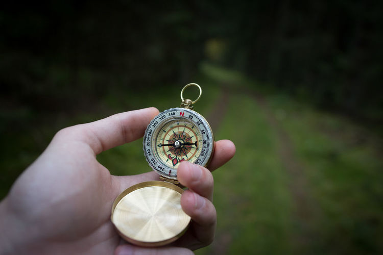 Bokeh Close-up Compass Dark Day Empty Road EyeEm EyeEm Best Edits EyeEm Best Shots Forest Full Frame Gold Grass Hand Holding Horizontal Human Body Part Macro North One Person Outdoors People Road Travel Turn