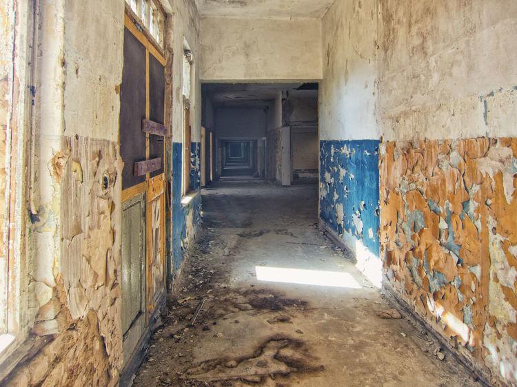 Hallway Abandoned Places Sanatorium Hohenlychen Hospital Weathered Damaged Deterioration Architecture Abandoned Blue Yellow No People Paint Decay Light And Shadow