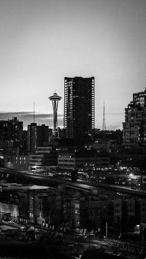 Illuminated cityscape against clear sky