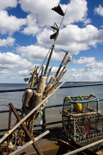 Fishing tackle on Filey promenade File Filey Seafront Fishing Tackle Fishing Net Yorkshire Beauty In Nature Cloud - Sky Clouds Day Fishing Horizon Over Water Moored Nature Nautical Vessel No People Outdoors Rope Sailing Ship Scenics Sea Seaside Sky Transportation Water