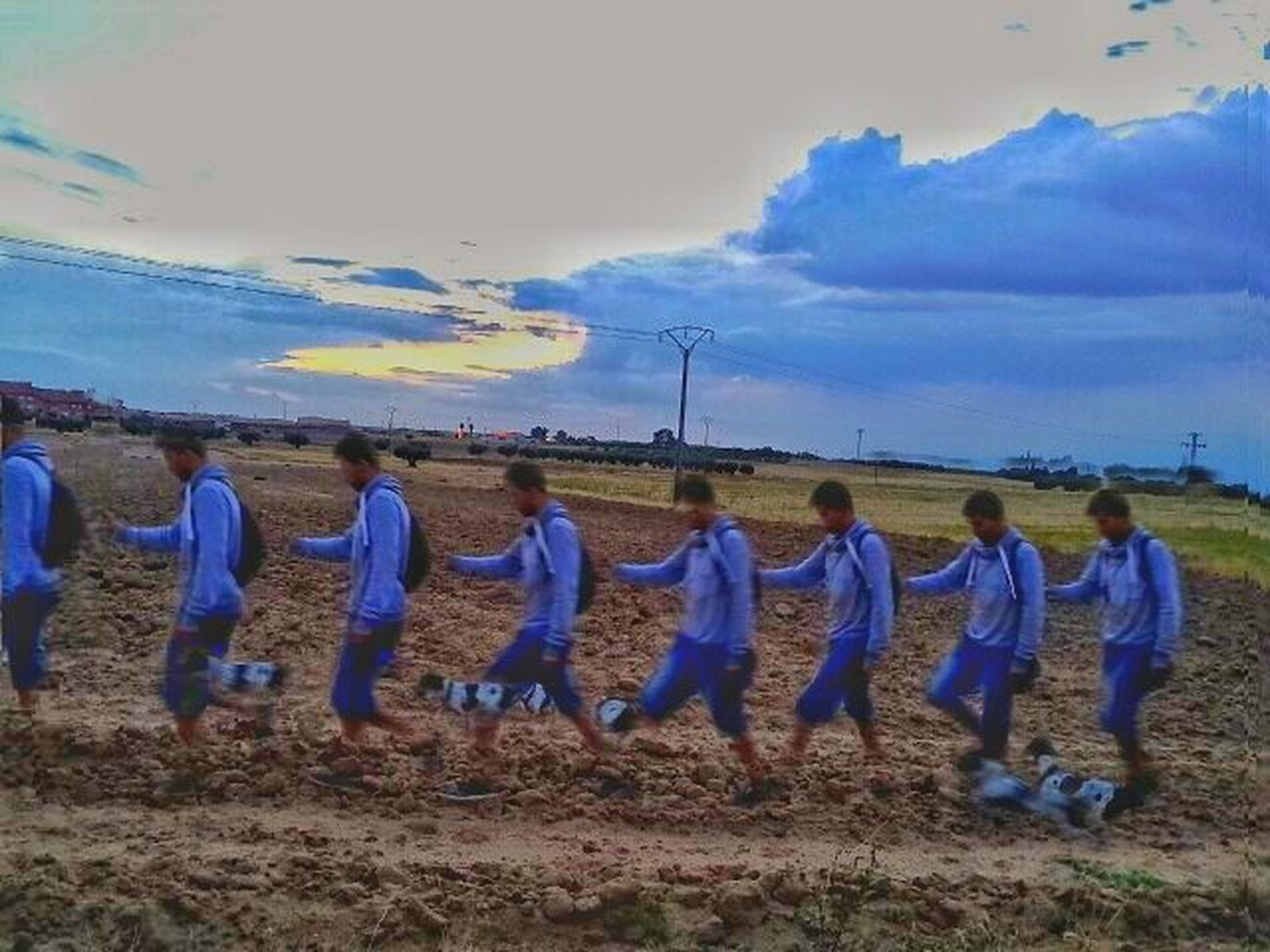 sky, landscape, cloud - sky, field, cloudy, large group of people, men, cloud, person, leisure activity, lifestyles, nature, rural scene, tranquil scene, blue, agriculture, tranquility, scenics, beauty in nature