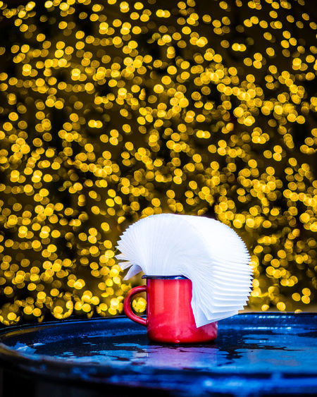 Lights around a red mug on a blue table. EyeEm Best Edits EyeEm Best Shots Still Life Photography StillLifePhotography The Week on EyeEm Bokeh Close-up Container Day Decoration Drink Floating Floating On Water Focus On Foreground Lighting Equipment Motion Nature No People Outdoors Selective Focus Still Life Water Waterfront Yellow The Still Life Photographer - 2018 EyeEm Awards EyeEmNewHere The Creative - 2018 EyeEm Awards