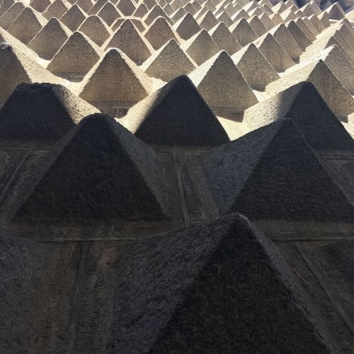 Low angle view of pyramid shapes on wall