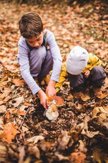 Full length of children on field during autumn
