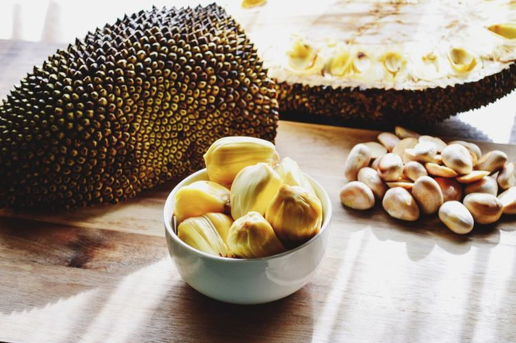 This is one of the largest fruits in the world! Called Jackfruit! My first time opening and eating one of these. You can only eat the pods raw. Though you can boil the seeds and they taste like sweet potatoes. The fruit itself tastes like a pineapple, banana and mango. Mmmmm. My particular Jackfruit weighed 20lbs! And cost me $20!!! 😂 Food And Drink Food Still Life Freshness Table No People Plate Indoors  Healthy Eating Nut - Food Close-up Ready-to-eat Day Jackfruit Large Huge Fruit Seeds Pods Sweet Exotic Exotic Fruit Aisia
