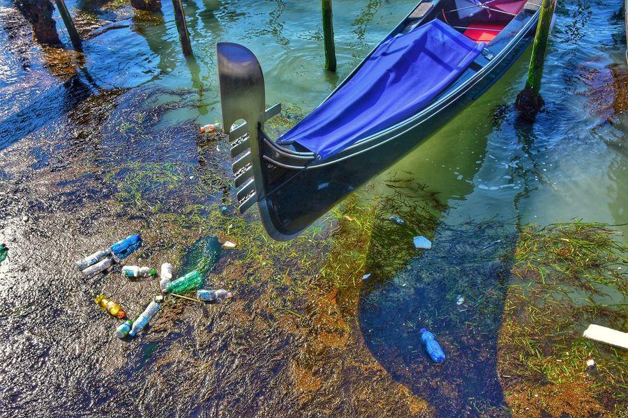 Venice Gondola - Traditional Boat Gondola Gondole In Venice Plastic Environment - LIMEX IMAGINE Water Multi Colored Full Frame Blue Close-up