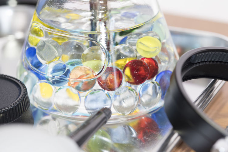 Close-up of colorful jelly balls in glass container