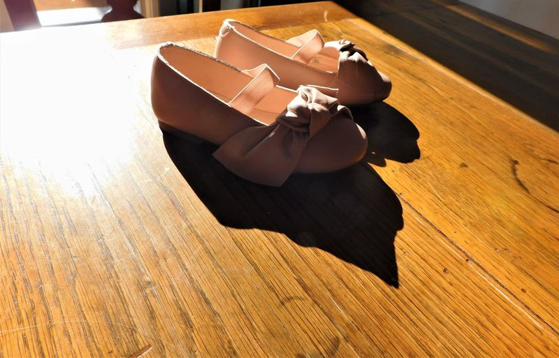 Copy Space Close-up Dancing Shoes Day Hardwood Floor High Angle View Indoors  Little Girl No People Pink Color Pink Shoes Shadows Shoes Sunlight Table Wood - Material