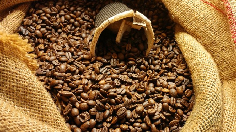 A bag of coffee beans Coffee Abundance Arabica Arabicacoffee Bag Brown Caffeine Cereal Plant Close-up Coffee Coffee - Drink Coffeebeans Food Food And Drink Freshness Healthy Eating High Angle View Indoors  Jute Large Group Of Objects No People Roasted Coffee Bean Sack Seed Still Life