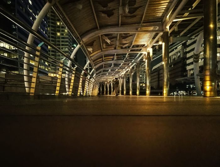After dark, nightlife in big city. Bridge Alone Nightlife After Work Cityscape Golden Night Pathway Skywalk Dark Lowlight Walkway HUAWEI Photo Award: After Dark Illuminated Ceiling Architecture Built Structure Roof TOWNSCAPE Skyline Light Urban Scene Roof Beam Tiled Roof  Rooftop