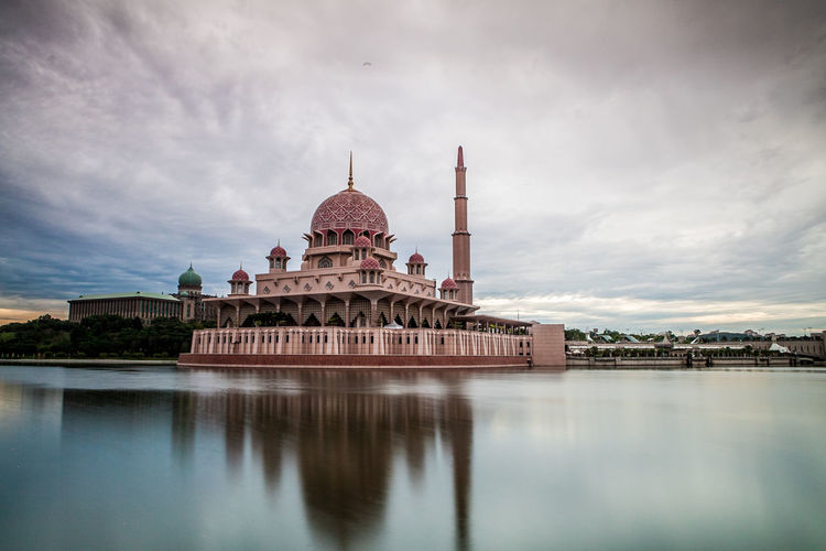 Reflection Of Putra Mosque In Lake Against Cloudy Sky