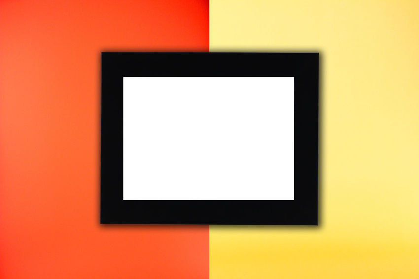 Black photo frame in red and yellow background Blank Close-up Day Flat Screen Indoors  Liquid-crystal Display No People Studio Shot Television Studio