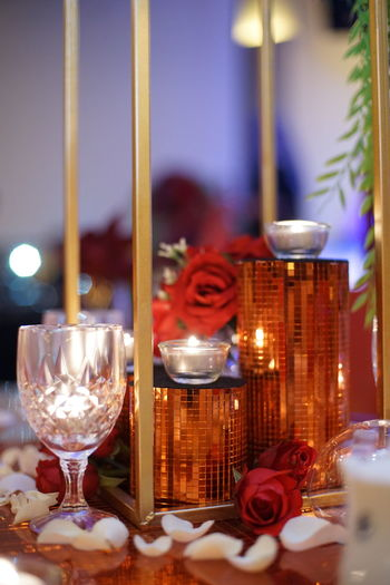 Red Wedding Candle Celebration Christmas Decoration Close-up Decoration Flower Focus On Foreground Food Gold Colored Illuminated Indoors  Night No People Place Setting Plate Red Spirituality Table Tea Light Wine Wineglass