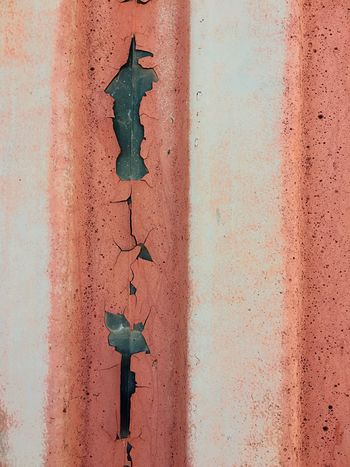 As the wall decays EyeEm Selects Wall - Building Feature Weathered Old Textured  No People Built Structure Close-up Rusty Metal Backgrounds Damaged Decline Peeling Off Outdoors Run-down Obsolete Deterioration