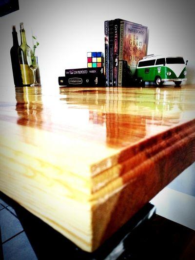 EyeEm New Here Desk Volkswagen Bamboo - Plant Bottles Of Wine Wooden Desk Books Bible Rubik's Cube