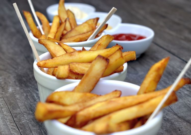 Home fries in bowls for snacks on wooden background. Wooden Fork American Dish EyeEmNewHere Food And Drink Fries Bowl Buffet Close-up Cuisine Maison Day Fast Food Food French Fries Freshness Fried Fried Food Fryer Gastronomy No People Potatoes Prepared Potato Snack Table Wooden Background