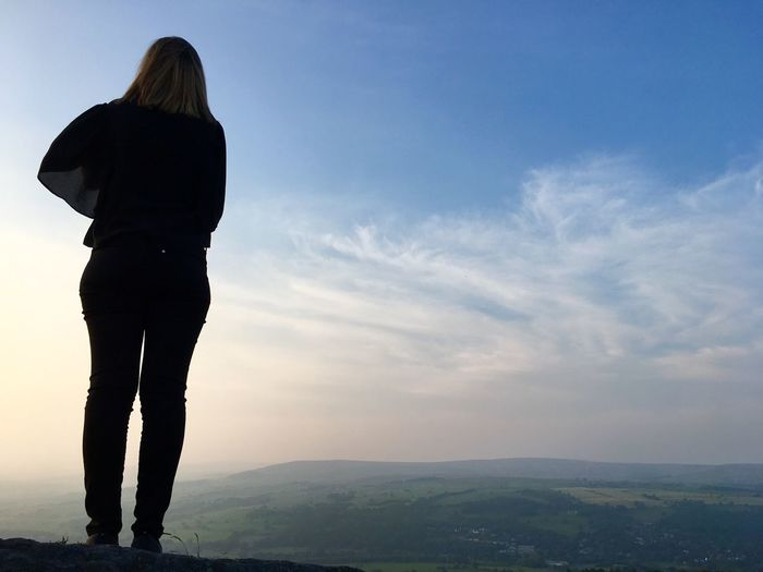 Silhouette of a woman stood on Ilkley Moor in Yorkshire, England Stood Alone United Kingdom England Yorkshire Ilkley Ilkley Moor Sky One Person Rear View Real People Cloud - Sky Standing Leisure Activity Beauty In Nature Lifestyles Scenics - Nature Women Adult Tranquil Scene Tranquility Environment Landscape Full Length Casual Clothing Outdoors