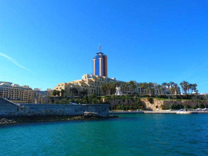 Malta Paceville San Giljan St. Julian's Mediterranean  Mediterranean Sea Architecture Water Built Structure Building Exterior Clear Sky Sky Travel Destinations Building Tower Day Blue