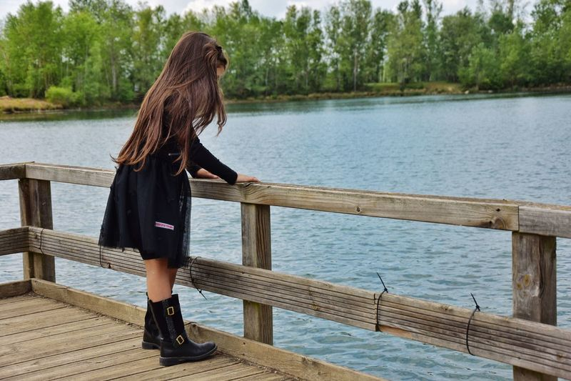 Lake Boots Dress Water One Person Real People Women Standing Full Length Leisure Activity Lifestyles Long Hair Nature Day Hairstyle Hair Wood - Material