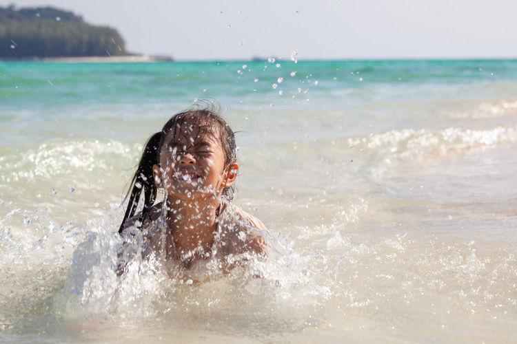 Girl playing in sea