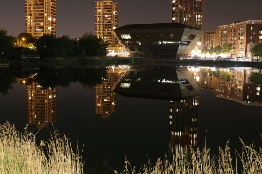London Architecture Building Building Exterior Built Structure Canada Water City Glowing Grass Illuminated Lake Nature Night No People Outdoors Plant Reflection Reflections In The Water Sky Symmetry Water Waterfront