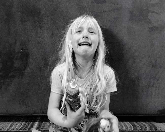 Childhood One Person Real People Blond Hair Girls Elementary Age Child Front View Sitting Children Only Indoors  Portrait Day People Sadness Sorrow Remorse Barbie Doll Broken The Portraitist - 2017 EyeEm Awards Press For Progress