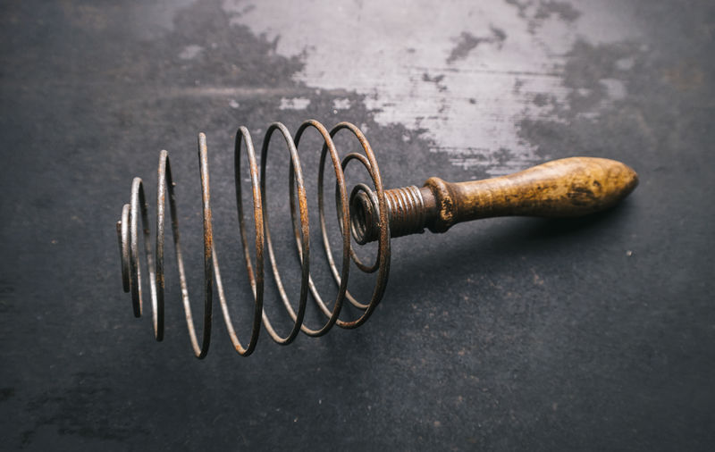 Close-up of wire whisk on table